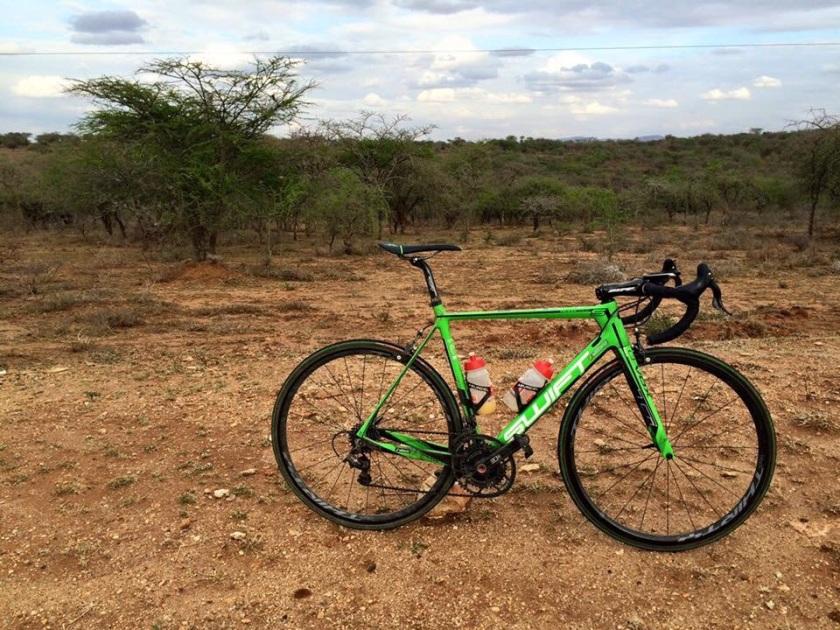 Me and my bike. Background- Gods creation-Beautiful Kenya